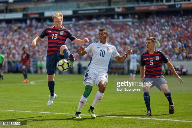 United States defender Matt Besler and United States midfielder Dax McCarty battles with Panama forward Ismael Diaz for a loose ball during a...