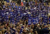 Delegates wave signs saying 'Win One for the Gipper' to support Michael Reagan who introduced a video tribute to his father former President Ronald...