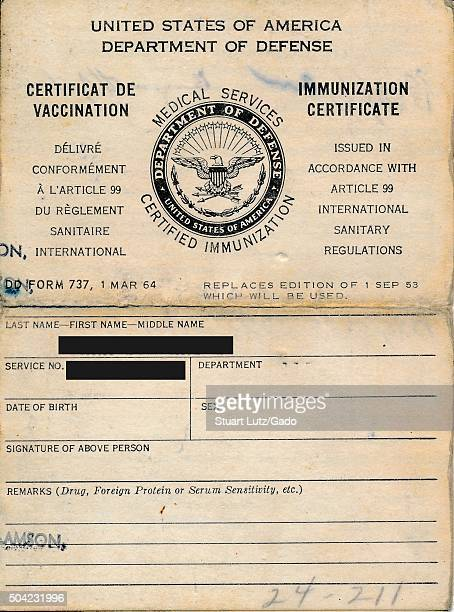 United States Department of Defense medical services immunization certificate listing the name and identity of a soldier who has been vaccinated...