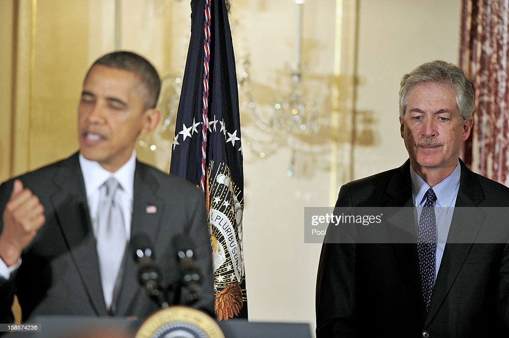 United States Deputy Secretary of State <a gi-track='captionPersonalityLinkClicked' href=/galleries/search?phrase=William+J.+Burns&family=editorial&specificpeople=1151199 ng-click='$event.stopPropagation()'>William J. Burns</a> (R) listens as U.S. President <a gi-track='captionPersonalityLinkClicked' href=/galleries/search?phrase=Barack+Obama&family=editorial&specificpeople=203260 ng-click='$event.stopPropagation()'>Barack Obama</a> delivers remarks at the Diplomatic Corps Holiday Reception on December 19, 2012 in Washington, D.C. President Obama announced that he is making an administration-wide effort to solve gun violence and has tapped Vice President Joseph Biden to lead the effort in the wake of the Sandy Hook Elementary School shooting in Newtown, Connecticut.