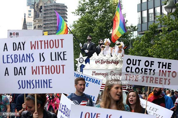 United States embassy employees attend the Christopher Street Day gay parade in Berlin on June 27 2015 AFP PHOTO / ADAM BERRY