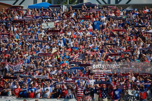 United States fans hold up their scarf's and flags during a CONCACAF Gold Cup Group B match between the United States v Panama at Nissan Stadium on...