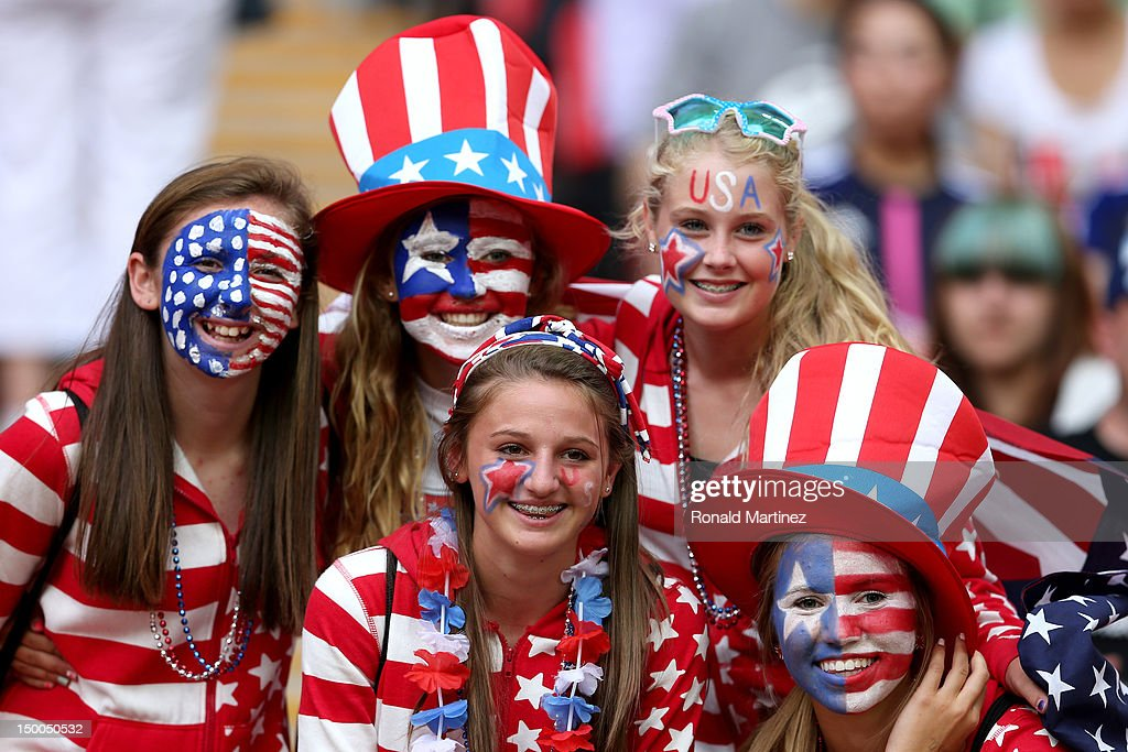United States fans pose for pictures before the United States takes on Japan in the Women's Football gold medal match on Day 13 of the London 2012 Olympic Games at Wembley Stadium on August 9, 2012 in London, England.