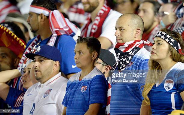 United States fans react after Oribe Peralta of Mexico scored a goal in the first extra time against the United States in the 2017 FIFA...