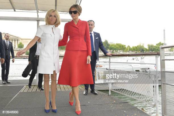 United States First Lady Melania Trump and French First Lady Brigitte Macron leave the dock after a boat ride on the Seine river on July 13 2017 in...