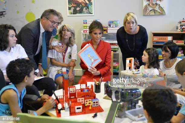 United States First Lady Melania Trump speaks with children as she visits Necker Hospital for children on July 13 2017 in Paris France The United...