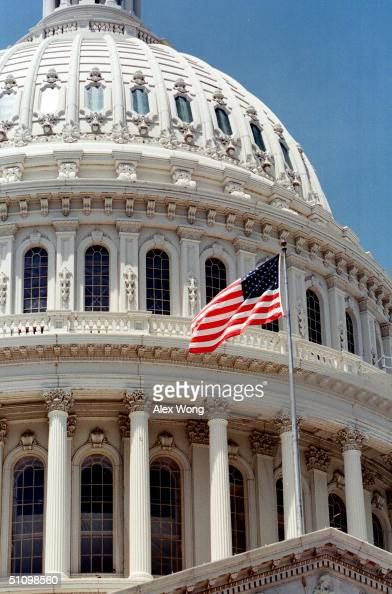 A United States Flag Flies On The Capitol Building In Washington Dc June 22 1999