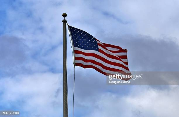 United States flag in the blue sky