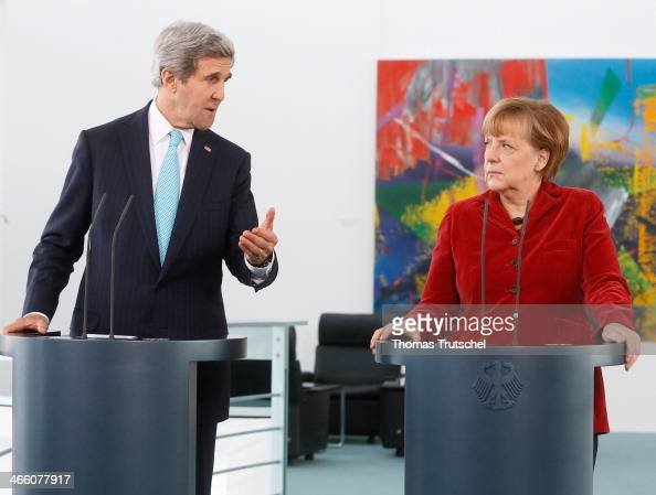 United States Foreign Minister John Kerry and German Chancellor Angela Merkel speak to the media at the German Federal Chancellery on January 31 2014...