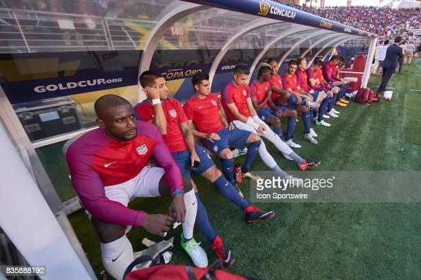 United States forward Clint Dempsey and United States players sit on the bench during the CONCACAF Gold Cup Final match between the United States v...