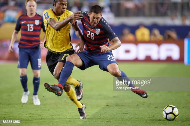 United States forward Clint Dempsey battles with Jamaica midfielder Michael Binns for the ball during the CONCACAF Gold Cup Final match between the...