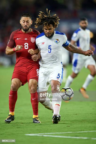 United States forward Clint Dempsey battles with Panama defender Roman Torres during the World Cup Qualifying match between the the United States and...