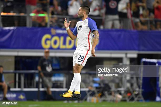 United States forward Clint Dempsey celebrates with teammates after scoring a goal in the second half during a CONCACAF Gold Cup Semifinals match...