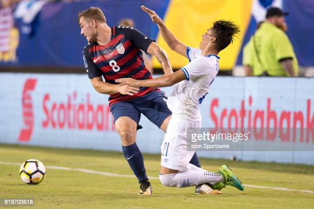 United States Forward Jordan Morris and El Salvador Defender Bryan Tamacas collide in the second half during the CONCACAF Gold Cup Quarterfinal game...