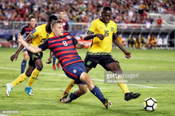 United States forward Jordan Morris battles with Jamaica midfielder JeVaughn Watson for a loose ball during the CONCACAF Gold Cup Final match between...