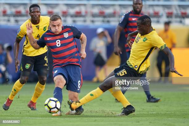 United States forward Jordan Morris battles with Jamaica midfielder JeVaughn Watson for the ball during the CONCACAF Gold Cup Final match between the...