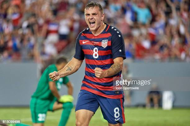 United States forward Jordan Morris celebrates with teammates after scoring a goal during a CONCACAF Gold Cup Group B match between the United States...