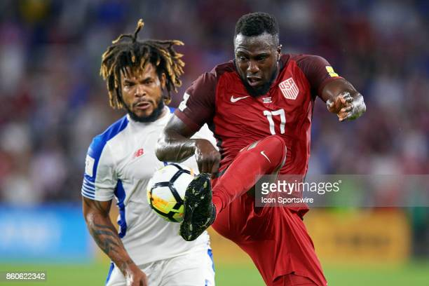 United States forward Jozy Altidore battles with Panama defender Roman Torres to kick the ball during the World Cup Qualifying match between the the...