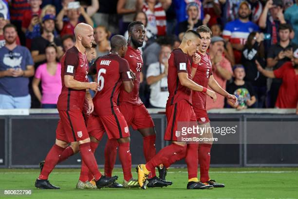 United States forward Jozy Altidore celebrates with teammates after scoring a goal during the World Cup Qualifying match between the the United...