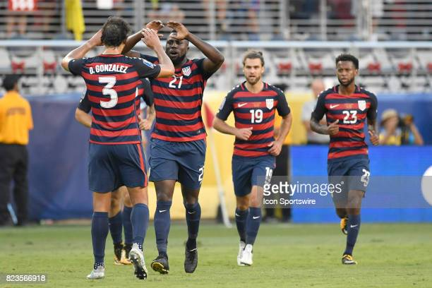 United States forward Jozy Altidore celebrates with teammates and fans after scoring a goal during the CONCACAF Gold Cup Final match between the...