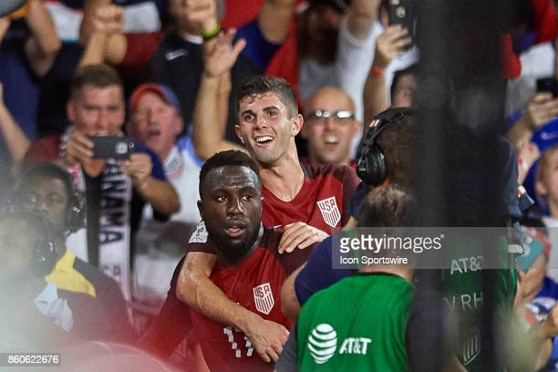 United States forward Jozy Altidore celebrates with United States midfielder Christian Pulisic after scoring a goal during the World Cup Qualifying...