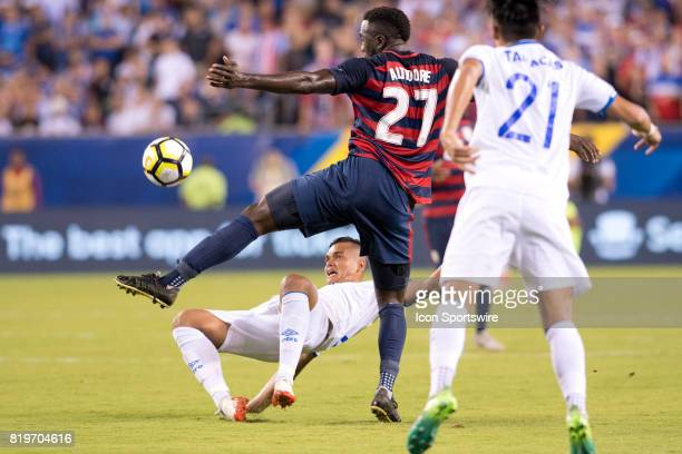 United States Forward Jozy Altidore receives a pass over El Salvador Defender Henry Romero in the second half during the CONCACAF Gold Cup...
