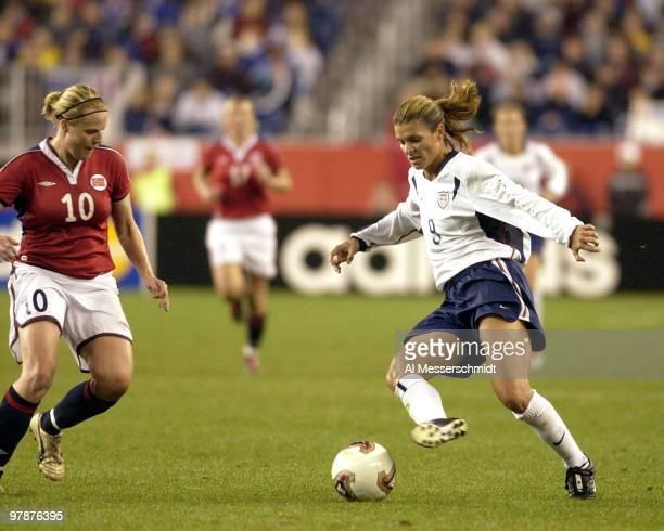 United States forward Mia Hamm turns the corner against Norway midfielder Unni Lehn October 1 2003 at Gillette Stadium Foxboro Massachuttes during...