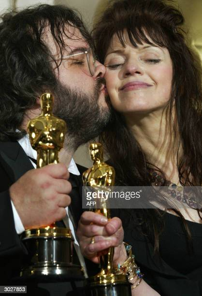 Fran Walsh is kissed by director Peter Jackson as they pose with their Oscar for Best Adapted Screenplay at the 76th Academy Awards ceremony 29...