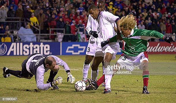 United States goalkeeper Brad Friedel dives for the ball as defender Tony Sanneh holds off Mexico forward in the first half of their CONCACAF World...