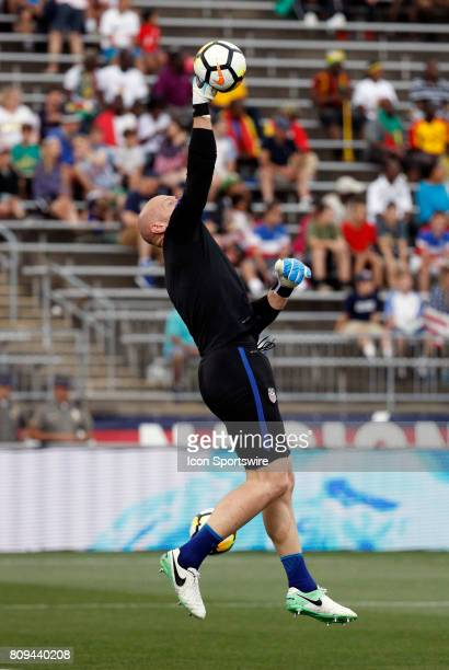 United States goalkeeper Brad Guzan punches the ball away in warm up before an international friendly between the United States and Ghana on July 1...
