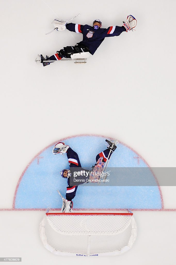 United States goalkeepers Jen Lee (top) and Steve Cash warm up prior to the Ice Sledge Hockey Preliminary Round Group B match between the United States of America and Russia during day four of Sochi 2014 Paralympic Winter Games at Shayba Arena on March 11, 2014 in Sochi, Russia.
