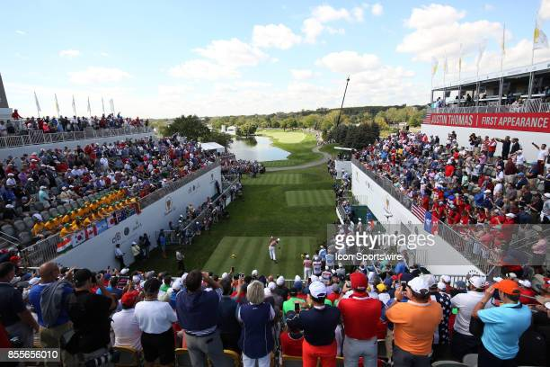 United States golfer Justin Thomas tees off on the first hole during the second round of the Presidents Cup at Liberty National Golf Club on...