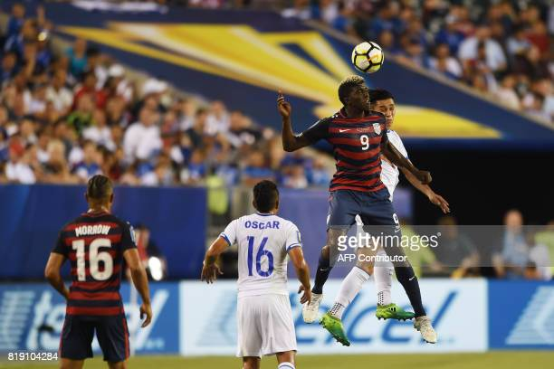 United States' Gyasi Zardes goes up for a header against El Salvador's Bryan Tamacas during their CONCACAF tournament quarterfinal match in...