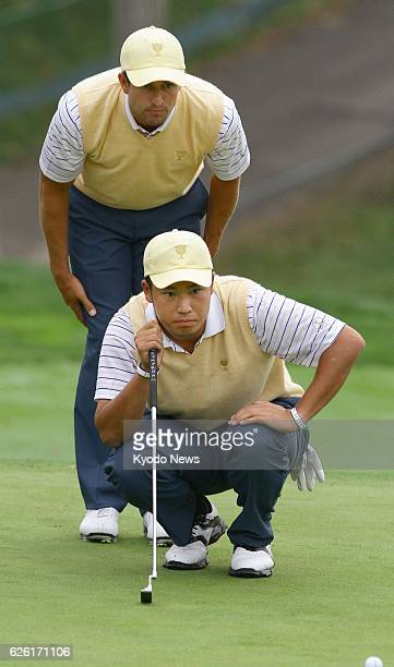 DUBLIN United States Japanese golfer Hideki Matsuyama along with his playing partner Adam Scott of Australia reads the line of a birdie putt at the...