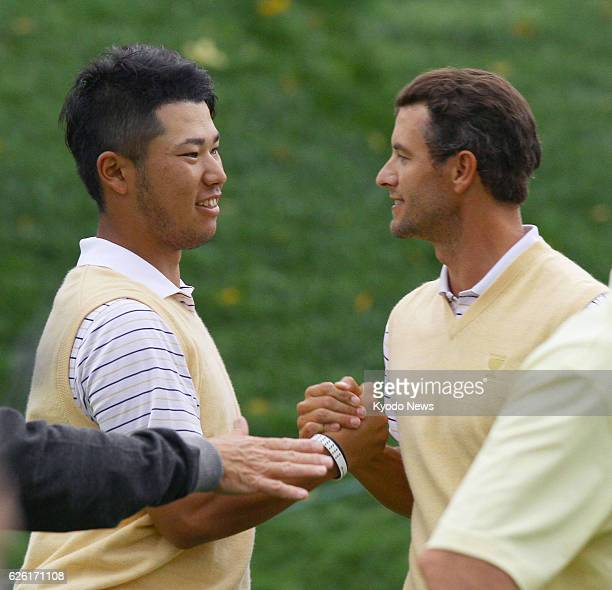 DUBLIN United States Japanese golfer Hideki Matsuyama and his playing partner Adam Scott of Australia shake hands after defeating Jason Dufner and...