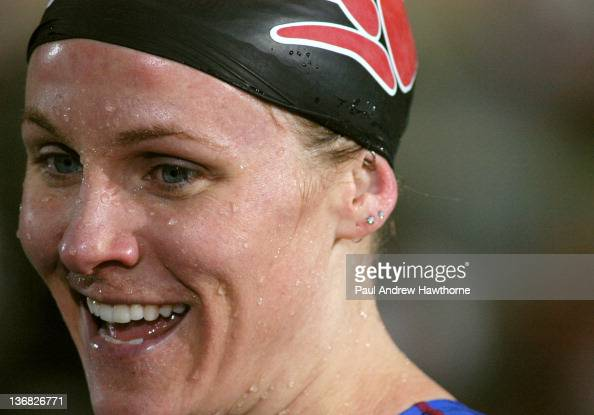 United States' Jenny Thompson is all smiles after tying for first place in the 100meter butterfly with Slovakia's Martina Moravcova during Friday...