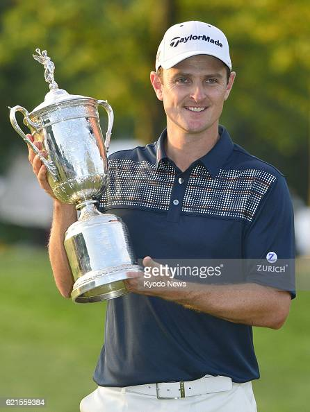 ARDMORE United States Justin Rose of England holds the victor's trophy after winning the US Open championships at Merion Golf Club in Ardmore...
