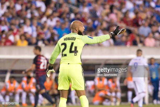 United States Keeper Tim Howard calls out to his teammates in the first half during the CONCACAF Gold Cup Quarterfinal game between the United State...