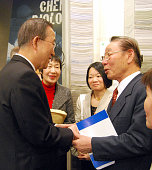NEW YORK United States Lee Sil Gun an atomicbomb survivor shakes hands with UN Secretary General Ban Ki Moon during an opening event on March 24...