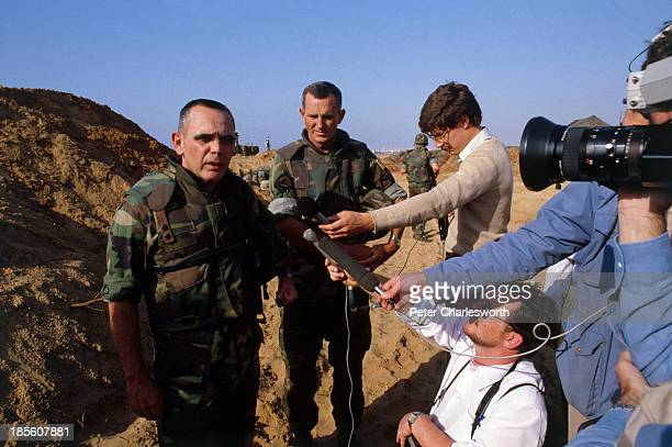 United States Marine Commander General James Joy and Lieutenant Colonel Ray Smith speaks to the media at an outdoor press conference after 8 US...