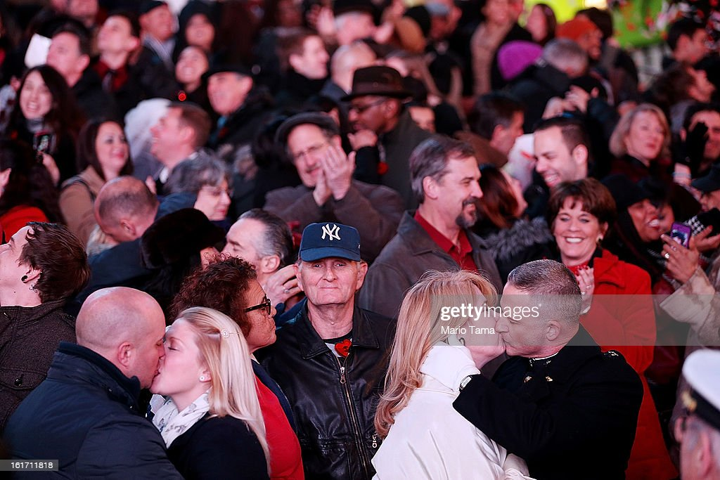 United States Marine Corps Capt. Eric Taush (Lower R) kisses wife Sue in Times Square during a vows renewal ceremony with other couples on Valentine's Day on February 14, 2013 in New York City. People around the world are celebrating the lovers holiday.