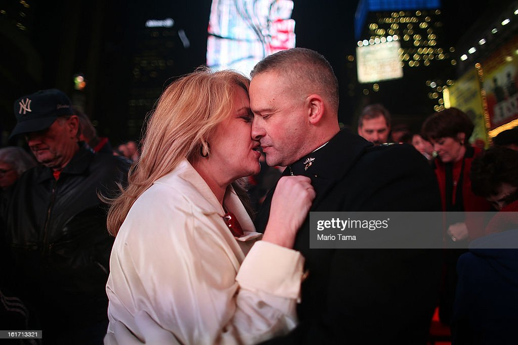 United States Marine Corps Capt. Eric Taush (Lower-R) kisses wife Sue in Times Square at the conclusion of a vows renewal ceremony with other couples on Valentine's Day on February 14, 2013 in New York City. People around the world are celebrating the lovers holiday.