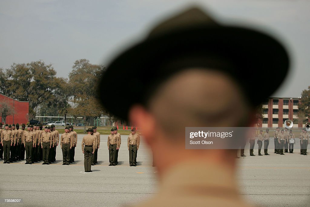 United States Marine Corps drill instructor watches recruits on the parade deck during boot camp March 8 2007 at Parris Island South Carolina The...