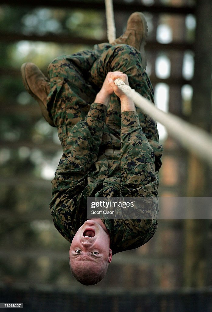 United States Marine Corps recruit Christopher Akery of Lyons Georgia works his way down an obstacle during boot camp March 8 2007 at Parris Island...