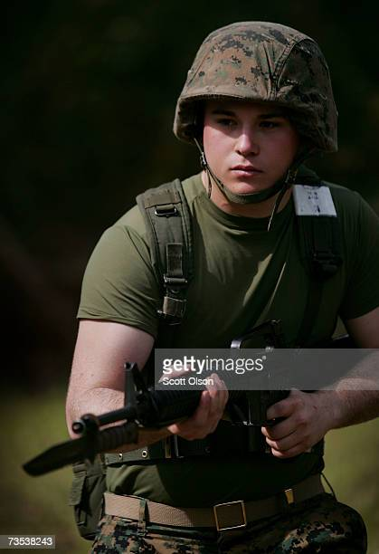 United States Marine Corps recruit runs through a bayonet assault course during training at boot camp March 8 2007 at Parris Island South Carolina...