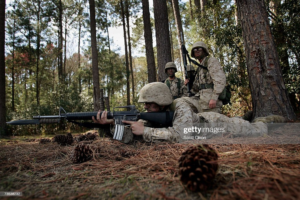 United States Marine Corps recruits Nathan Corthell of Greenwood Indiana prepares to run a bayonet assault course while while fellow platoon member...