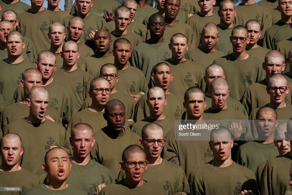 United States Marine Corps recruits recite answers to questions about Marine Corps history asked by their drill instructor during a break in training at boot camp March 6, 2007 at Parris Island, South Carolina. The Department of Defense has asked Congress to increase the size of the Marine Corps by 27,000 troops and the Army by 65,000 over the next five years.