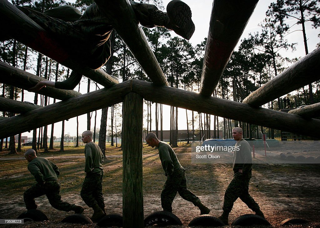 United States Marine Corps recruits run through an obstacle during boot camp March 8 2007 at Parris Island South Carolina The Department of Defense...