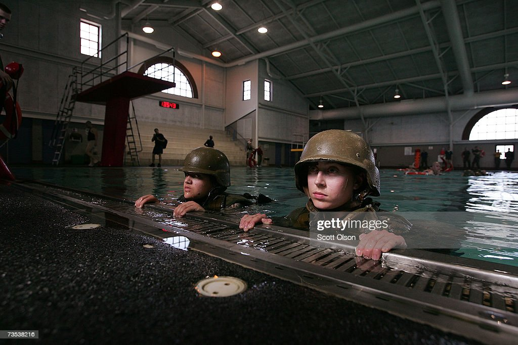 United States Marine Corps recruits Vanessa Skillings of Palmdale California and Felicia Gero of Plattsburgh New York participate in swim...
