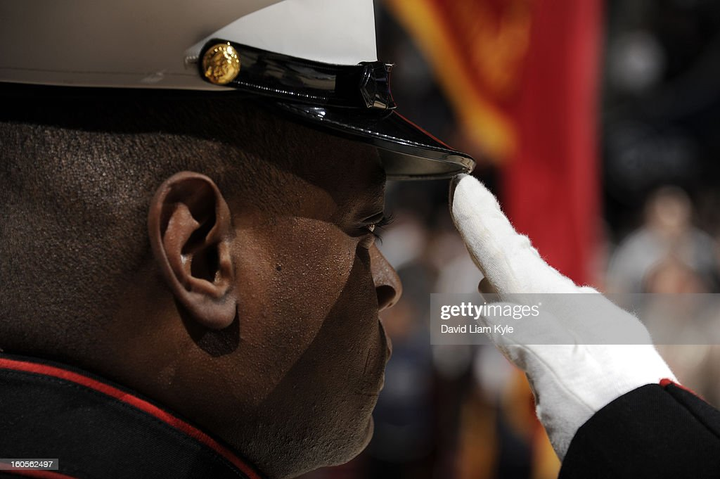 A United States Marine salutes the flag during the singing of the National Anthem prior to the game between the Cleveland Cavaliers and the Oklahoma City Thunder at The Quicken Loans Arena on February 2, 2013 in Cleveland, Ohio.